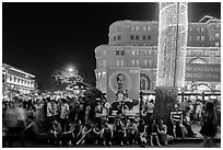 Revellers sitting on street, New Year eve. Ho Chi Minh City, Vietnam ( black and white)