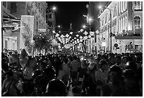 Packed street at night, New Year eve. Ho Chi Minh City, Vietnam (black and white)