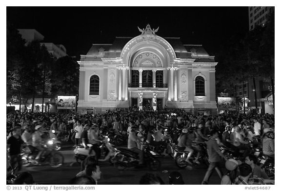 Crowds in front of Opera House at night. Ho Chi Minh City, Vietnam (black and white)