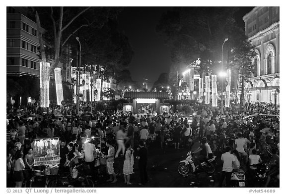 Le Loi boulevard crowds on New Year eve. Ho Chi Minh City, Vietnam (black and white)