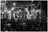 Crowds on street at night, New Year eve. Ho Chi Minh City, Vietnam (black and white)