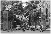 Street with holiday decorations. Ho Chi Minh City, Vietnam (black and white)