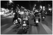 Motorbike riders at night from riders perspective. Ho Chi Minh City, Vietnam (black and white)