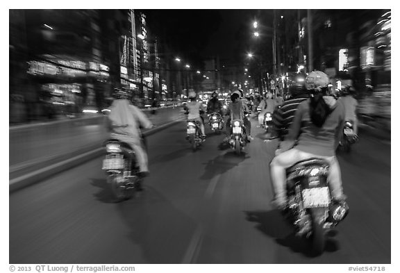 Riders view of motorcycle traffic at night. Ho Chi Minh City, Vietnam (black and white)