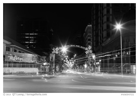 Dong Khoi street at night with light trails and decorations. Ho Chi Minh City, Vietnam (black and white)