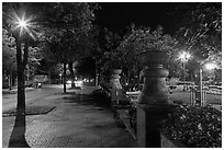 Sidewalk and park at night. Ho Chi Minh City, Vietnam ( black and white)