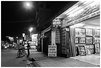 Stores selling pictures at night. Ho Chi Minh City, Vietnam ( black and white)
