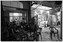 Communist party office and store selling images at night. Ho Chi Minh City, Vietnam ( black and white)