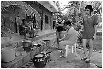 Vacationers frying fish in resort. Mui Ne, Vietnam ( black and white)