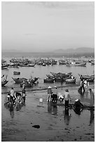 Miror-like beach and fishing boats, early morning. Mui Ne, Vietnam ( black and white)