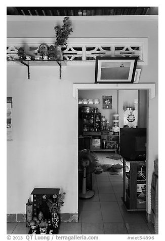 House interior with altars and picture. Mui Ne, Vietnam (black and white)