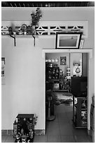House interior with altars and picture. Mui Ne, Vietnam ( black and white)