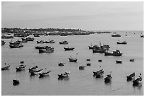 Fishing fleet and village. Mui Ne, Vietnam ( black and white)