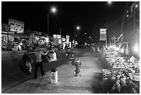 Stalls on main street at night. Mui Ne, Vietnam ( black and white)