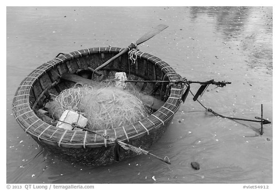 Round coracle boat with fishing gear. Mui Ne, Vietnam (black and white)