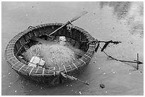 Round coracle boat with fishing gear. Mui Ne, Vietnam ( black and white)