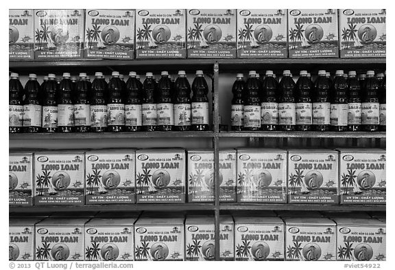 Fish sauce (nuoc mam) for sale. Mui Ne, Vietnam (black and white)