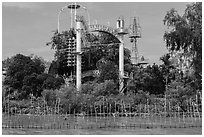 Coconut monk temple seen from water, Phoenix Island. My Tho, Vietnam (black and white)