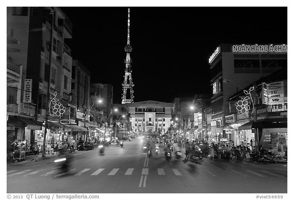 Main street and telecomunication tower at night. Tra Vinh, Vietnam (black and white)