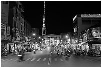 Main street and telecomunication tower at night. Tra Vinh, Vietnam ( black and white)