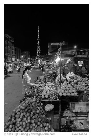Fruit vendor on main street at night. Tra Vinh, Vietnam (black and white)