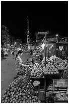 Fruit vendor on main street at night. Tra Vinh, Vietnam ( black and white)