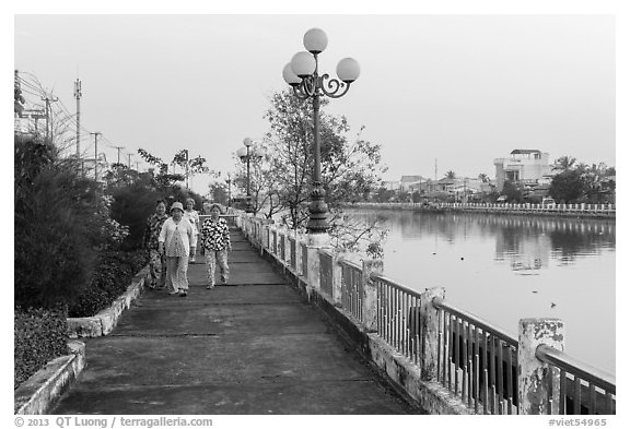 Elderly women strolling on riverfront. Tra Vinh, Vietnam (black and white)