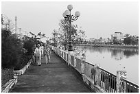 Elderly women strolling on riverfront. Tra Vinh, Vietnam ( black and white)
