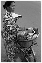 Woman vending food out of bicycle. Tra Vinh, Vietnam ( black and white)