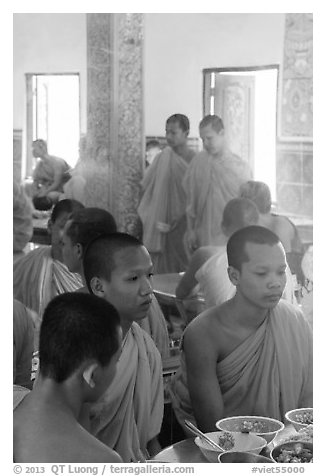 Theravada monks in dining room, Hang Pagoda. Tra Vinh, Vietnam (black and white)