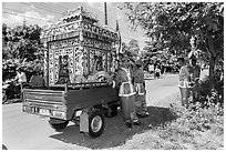 Funeral vehicle and attendants. Tra Vinh, Vietnam ( black and white)