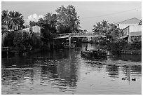 Barge and canal-side houses. Mekong Delta, Vietnam ( black and white)