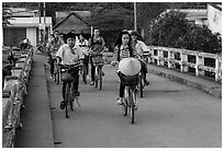 Children bike on way to school, Phung Diem. Can Tho, Vietnam ( black and white)
