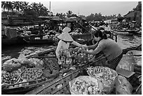 Fruit being sold from boat to boat, Phung Diem floating market. Can Tho, Vietnam ( black and white)