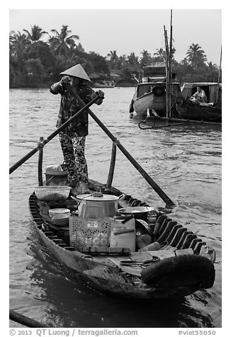 Woman paddles boat with pho noodles, Phung Diem. Can Tho, Vietnam (black and white)