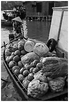 Woman paddles boat fully loaded with produce, Phung Diem. Can Tho, Vietnam ( black and white)