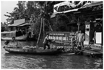 Women refilling boat tank. Can Tho, Vietnam ( black and white)