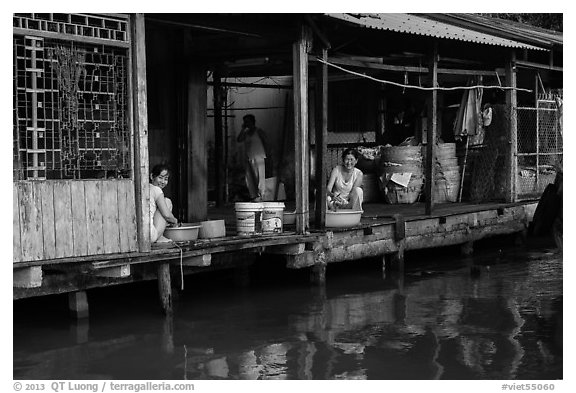 Riverside food preparation. Can Tho, Vietnam (black and white)