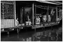 Riverside food preparation. Can Tho, Vietnam ( black and white)