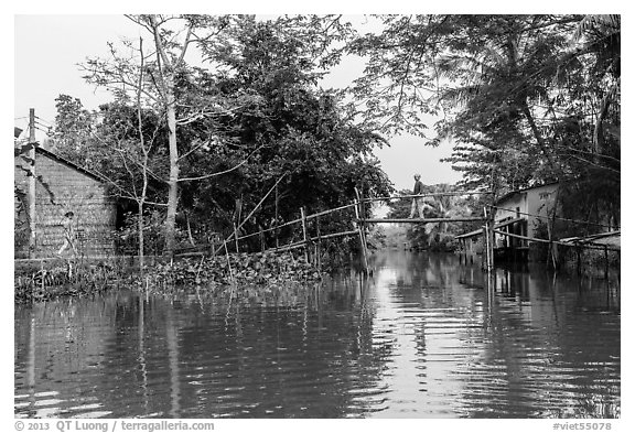 Riverside village and monkey bridge. Can Tho, Vietnam (black and white)