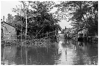 Riverside village and monkey bridge. Can Tho, Vietnam ( black and white)