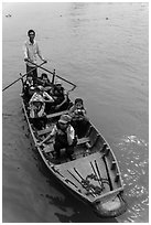 Schoolchildren rowed by parent. Can Tho, Vietnam ( black and white)