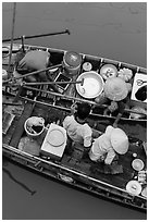 Couples on two side-by-side boats seen from above. Can Tho, Vietnam ( black and white)