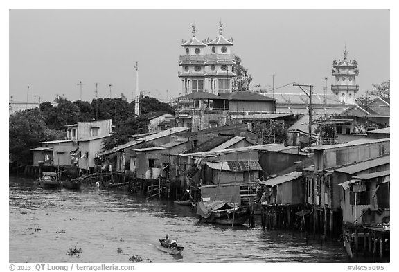 Riverside houses on stilts and Cao Dai temple. Mekong Delta, Vietnam (black and white)