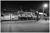 Street and stadium at night, District 8. Ho Chi Minh City, Vietnam ( black and white)