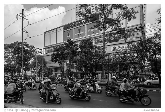 Motorcycle traffic and Hung Vuong Plaza mall. Cholon, Ho Chi Minh City, Vietnam (black and white)