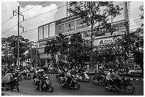 Motorcycle traffic and Hung Vuong Plaza mall. Cholon, Ho Chi Minh City, Vietnam ( black and white)