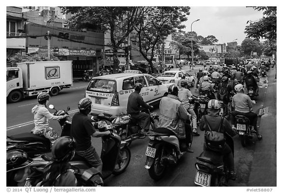 Dense motorcycle traffic. Ho Chi Minh City, Vietnam (black and white)