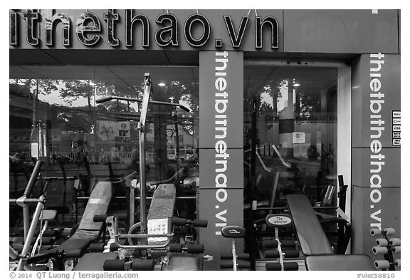 Store selling exercise equipment. Ho Chi Minh City, Vietnam (black and white)