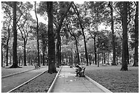 Couple looking at mobile phone, April 30 Park. Ho Chi Minh City, Vietnam ( black and white)